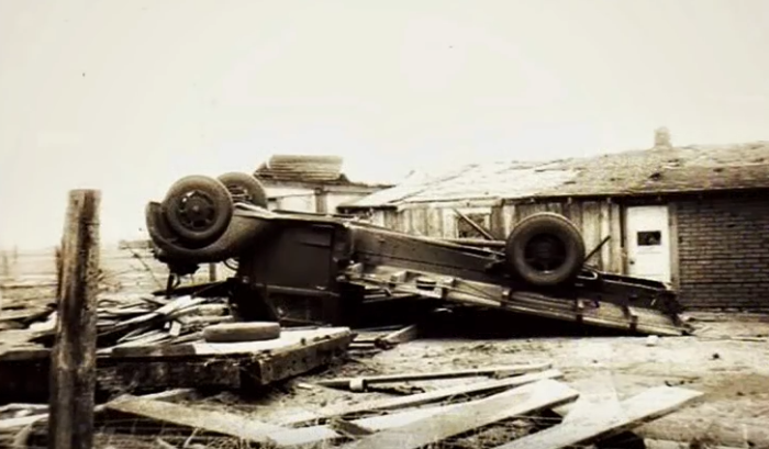 2. A flat-bed truck was found toppled upside down.