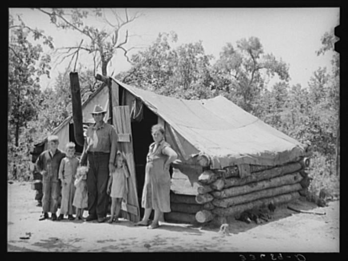 11. A family of six in front of their tent home near Sallisaw. They had moved into the tent to save rent and fuel money in town.