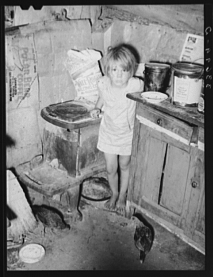 13. The corner of the kitchen in a tent home of a family near Sallisaw.