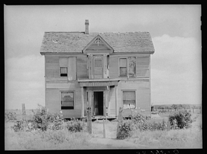 14. A run-down old mansion that was now occupied by several families in Muskogee County.