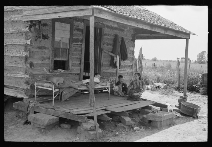 1. This tenant farmer and family are living in this worn down house in Warner, Oklahoma, and using the porch for additional sleeping space.