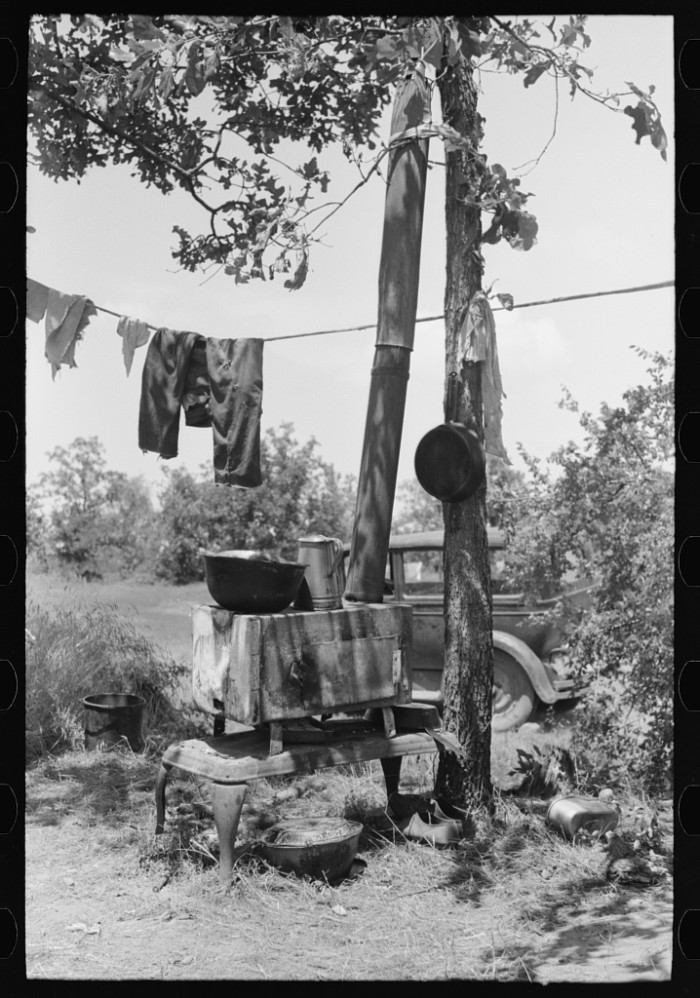 3. This stove and personal items belonged to an agricultural family camped by the roadside near Spiro.