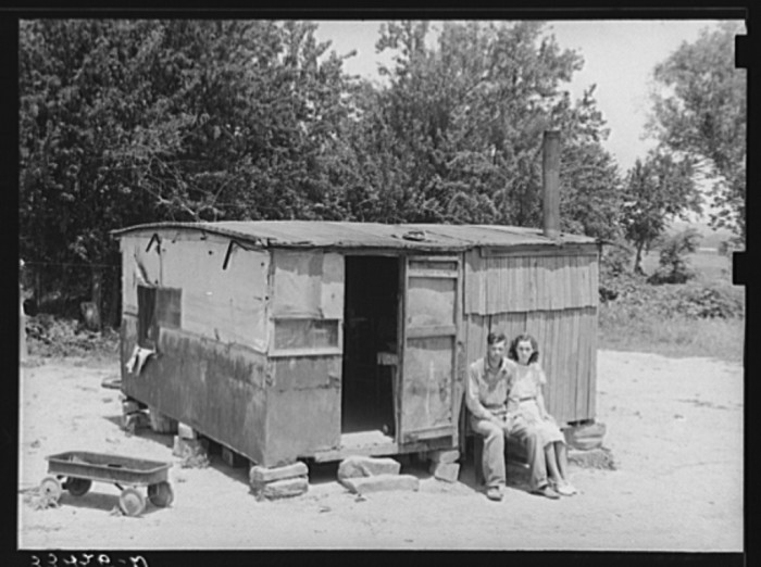 8.  A WPA (Works Progress/Work Projects Administration) worker and his wife sitting in front of their shack home on the Arkansas River near Webbers Falls.