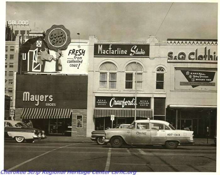 """8. This image of Randolph St. in Enid was taken in the 1950s. It is good to know that the milk came, """"Fresh...From Contented Cows!"""""""