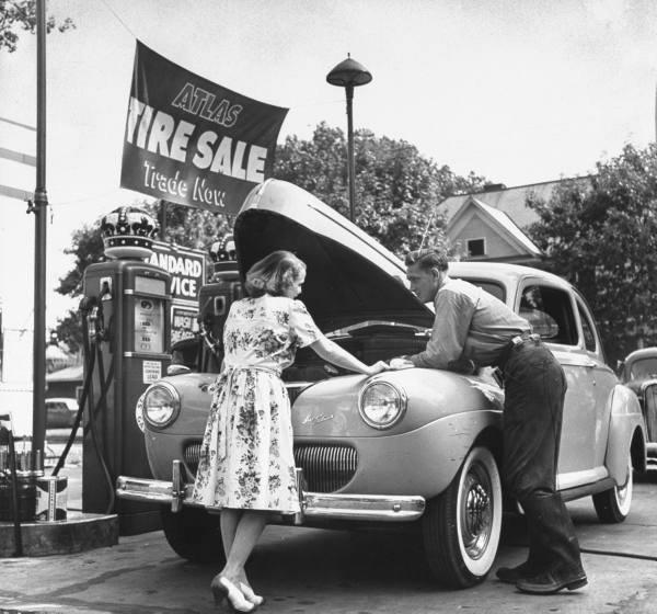 9. This man was helping a lady at a service station in Oklahoma City in 1950.