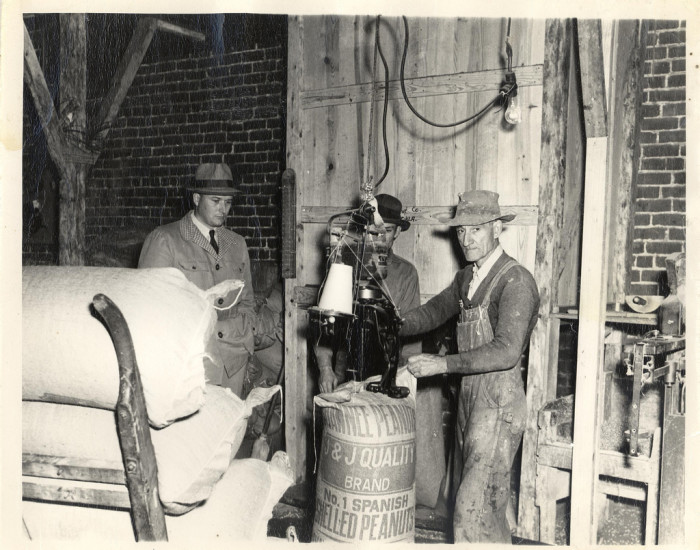 2. J.J. Quality Brand Peanuts being bagged in Shawnee in the 1950s.