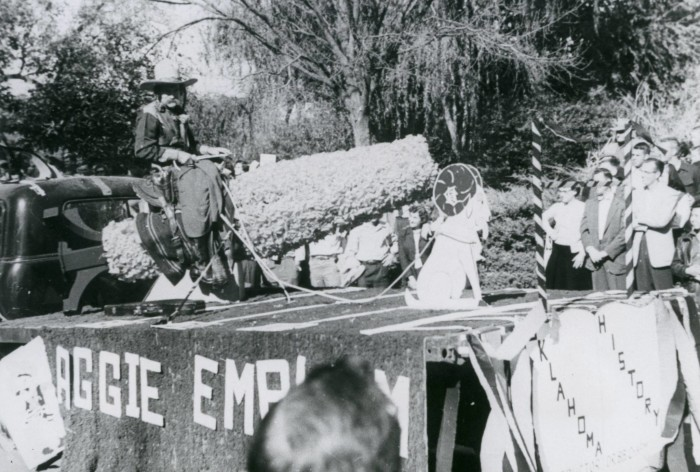 """18. Frank B. Eaton """"Pistol Pete"""" rode in the October 1957, homecoming parade to spur support to make his caricature sketch the school's official mascot. Eaton had been the unofficial mascot since 1923. He died the next April and Charley Lester appeared as Pistol Pete in the 1958 parade."""