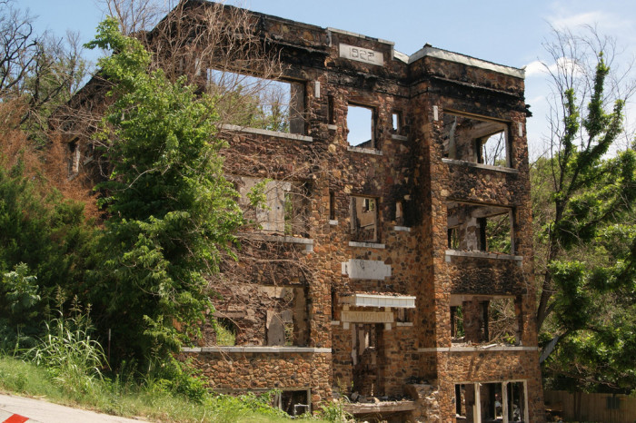 8. The four-story, six-unit Virginia Apartments at 10th and Kihekah in Pawhuska were built in 1922. They suffered a damaging fire, and all that remains are the ruins of the once-luxury apartments.