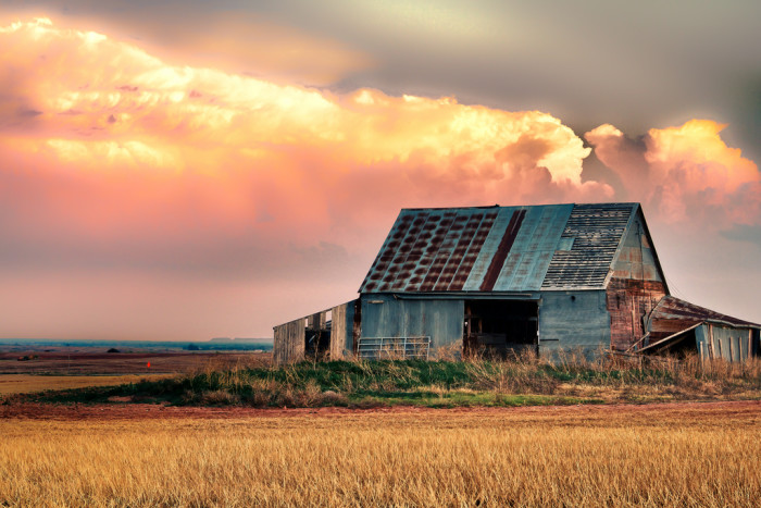 8. A beautiful barn against storm clouds.
