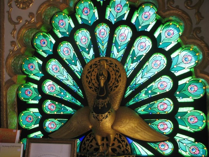 There are four peacock windows that display 1,500 pieces of hand-crafted stained glass. Real peacocks also roam the grounds.  The birds are traditionally associated with royalty and Lord Krishna, who wears a peacock feather in His hair.
