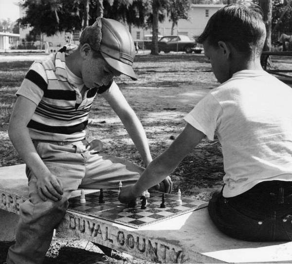 1. It's pretty rare to see young kids playing chess in the park like this anymore.