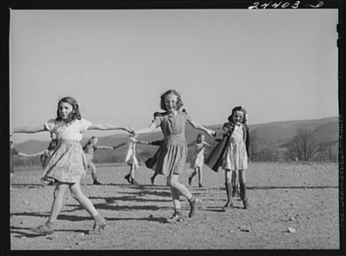 10. School children in Dailey play and sing during recess at a school in Dailey in 1941.