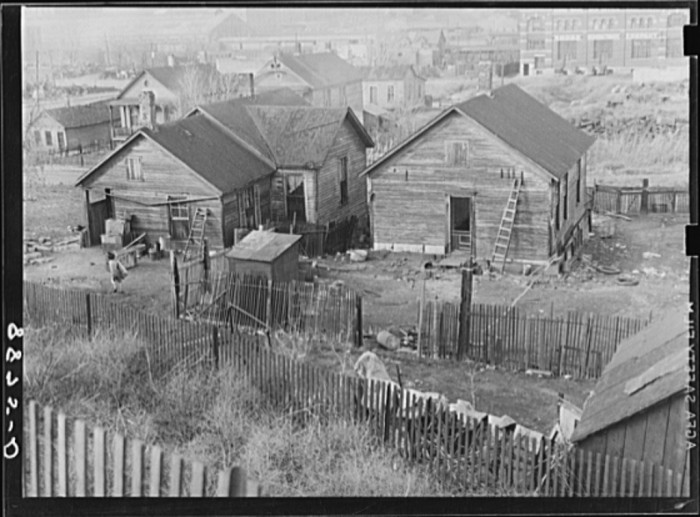 21. These ramshackle homes occupied a very undesirable location in Omaha: right next to railroad tracks - 1938.