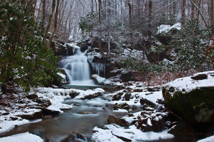 3. This beautiful mountain waterfall covered in snow.