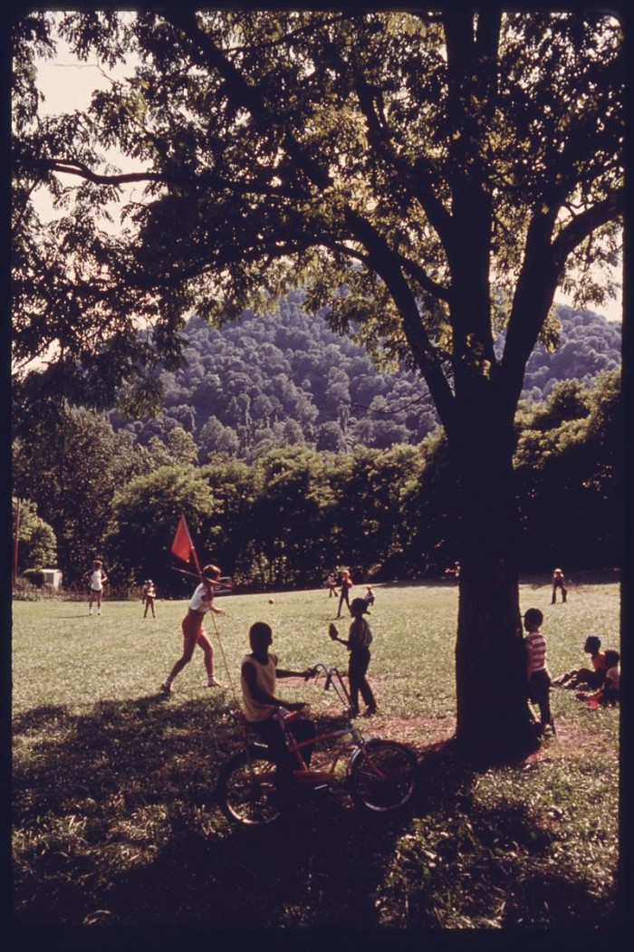 17. Kids play a game of softball in Boomer, 1975.