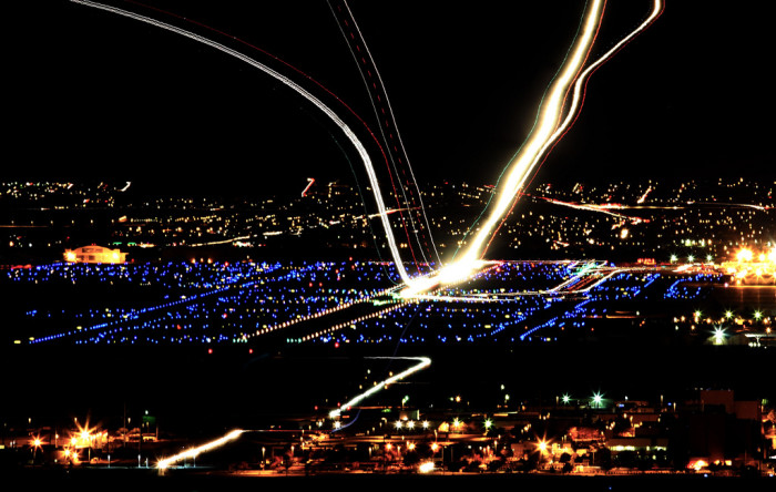 8. Through the use of long-exposure photography and image stitching, even shots of planes leaving Albuquerque's International Sunport appear surreal.