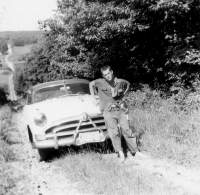 2. A young man stands with his 1951 Hudson in Hauer.