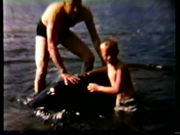 3. Father and son swim in Anvil Lake in 1957.