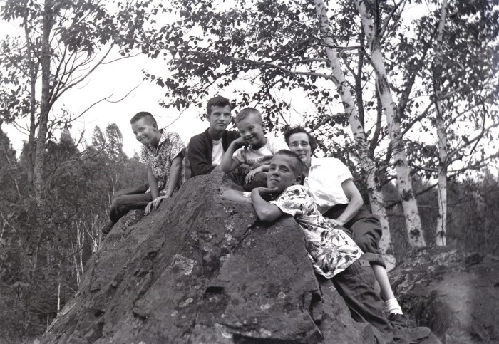 7. Children and mother hang out after climbing rocks in Black River in 1957.