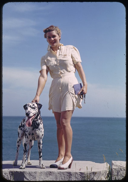 11. I love this shot of this young woman and her dog along the shores of Lake Michigan.