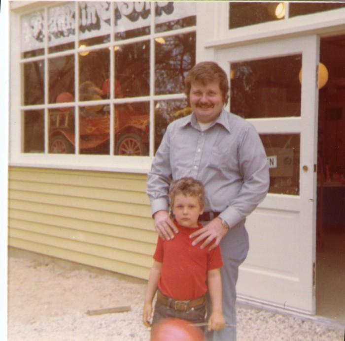 """5. Father and son pose in front of the """"Franklin and Son"""" store in Long Grove."""