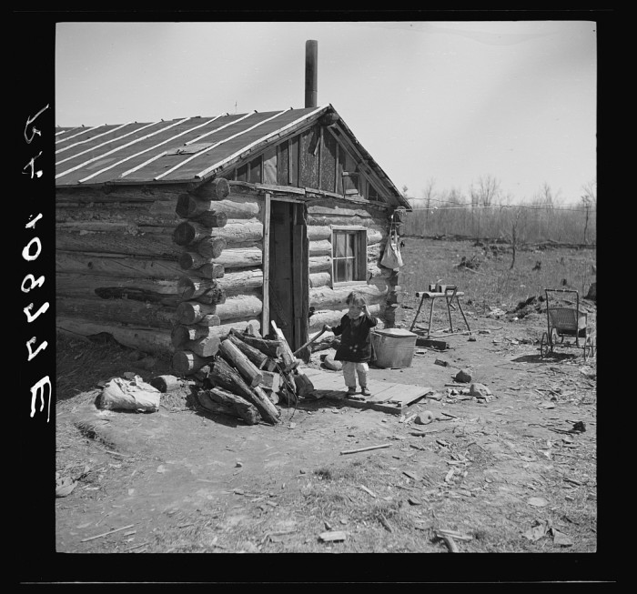 1. A child stands in front of the family home near Tipler, Wisconsin in 1937.