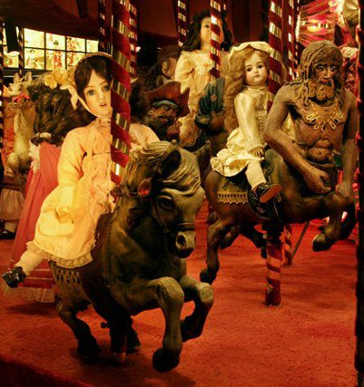 3. So here is where things start to get disturbing, at least for some of us. Yes, that is a carousel for dolls.