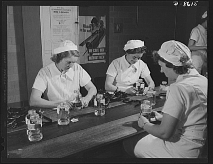 1.Housewives in war produce blood transfusion bottles. They were employed by Baxter Laboratories, Glenview, Illinois, these women workers are shown banding bottles used by the armed forces for blood transfusions, plasma, and serum. Evelyn Kohl (left) and Olive Western (right) each have two children; Gladys Eldert (right foreground) has a husband and brother in the Army