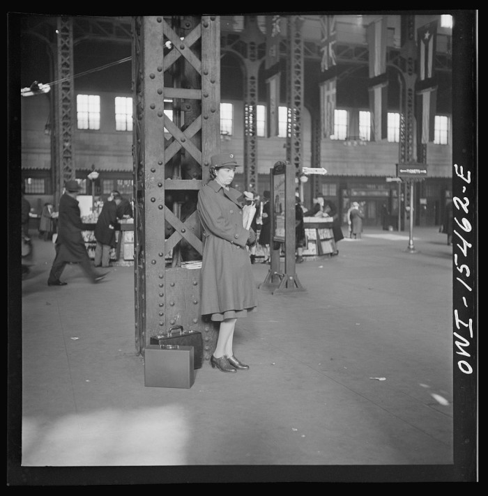 4. A member of the Women's Army Auxiliary Corps waits for a train in Union Station.