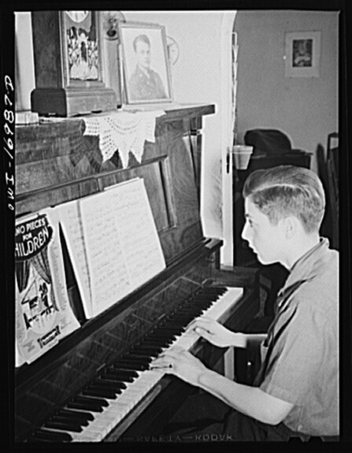 5. A boy plays piano while awaiting his brother to return back from the war.