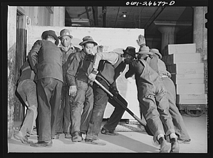 7. Freight handlers move a very heavy piece of freight at the United States Army consolidating station in 1943.
