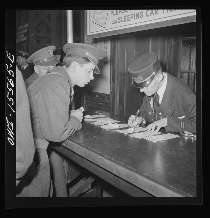 12. A soldier checks in on his train reservation at the Union Station.