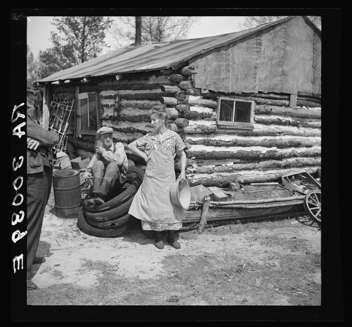 4. Mrs. Hale and her oldest son relax in front of their home near Black River Falls, Wisconsin. Total cost of the home: $3. No, really.