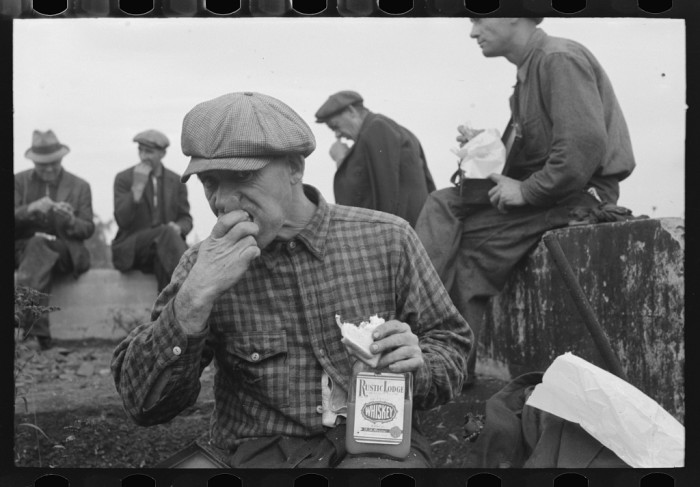 1. Railroad workers eating lunch.