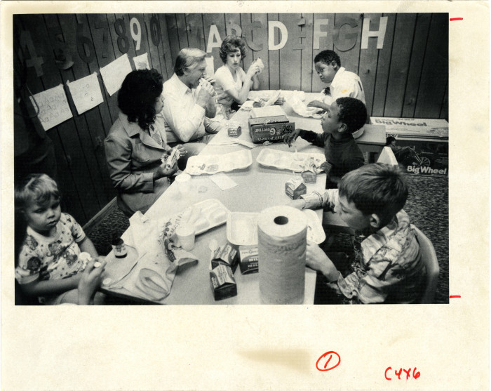 1. Mississippi Governor Cliff Finch joins a group of school children for lunch in 1976.