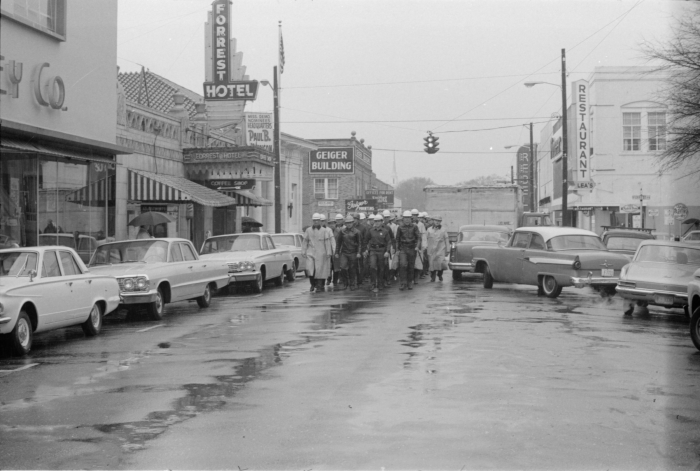 "10. On January 22, 1964, hundreds of African-Americans marched for equal rights in Hattiesburg, a day that would forever be remembered as Freedom Day. Taken on that historic day, this photograph shows a ""riot squad"" marching down Hattiesburg's Pine Street."
