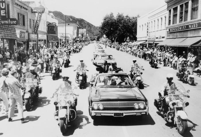 "5. ""Astronaut M. Scott Carpenter, pilot of the Mercury-Atlas 7 (MA-7) mission, and his wife participate in a postflight parade in Boulder, Colorado."" (1962)"