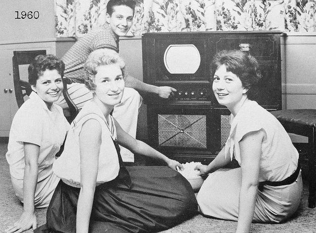 7. Some girls pose in front of a television in Midland, PA, 1960.