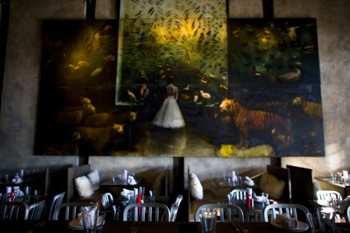 Floor-to-ceiling Todd Murphy paintings make this restaurant truly rare in design.
