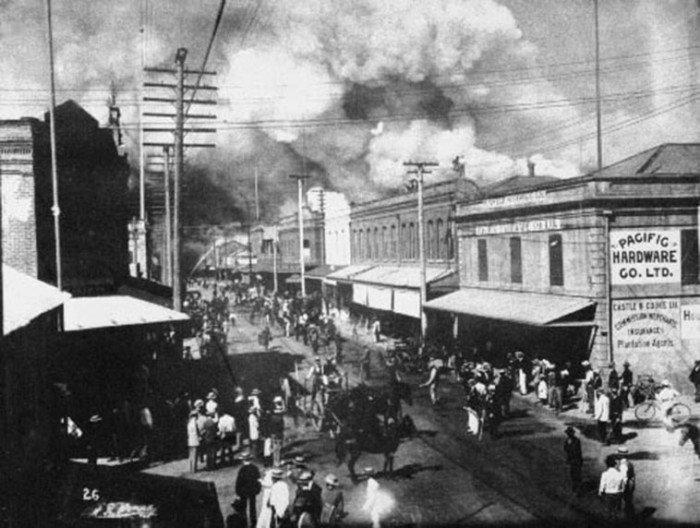 11. A fire burns in Honolulu's Chinatown in 1900. The fire was set to destroy homes suspected of being infected by the bubonic plague.