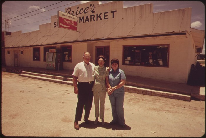 1. A family stands in front of the grocery store they proudly own. (Leakey, 1971)
