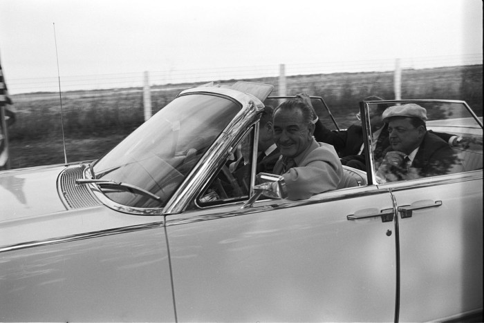 2. President LBJ drives his car at his ranch, not a care in the world.