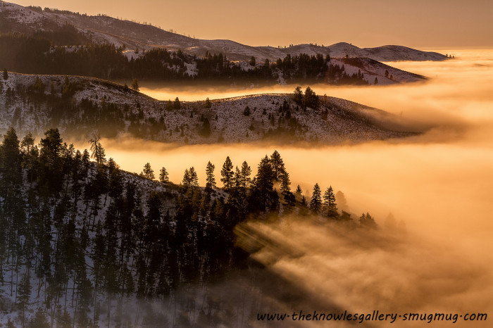 9. An inversion fog rolling in near Boise makes for a stunning sight as the sun shines through it.