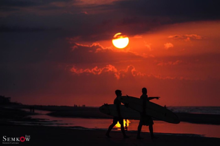9. Surfers at sunset