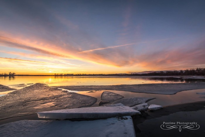 Lake McConaughy is looking frosty with an ice jam under a winter sunset.
