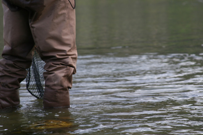 3. Waders and fishing gear.