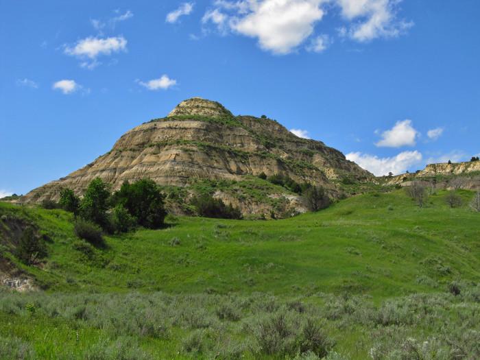 11. Perfectly cut hill among beautiful scenery.