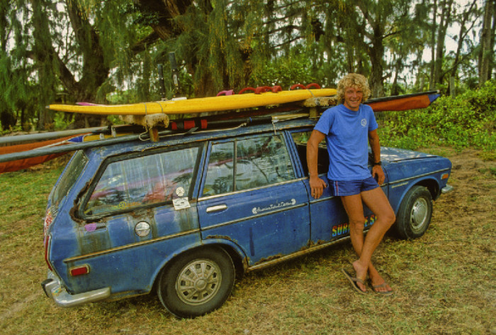 14. A surfer leans against his car in the late 1970s.