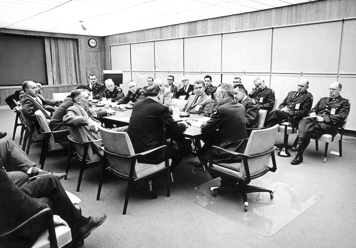 10. Dr. Wernher von Braun and the NASA team meet in the conference room of building 4488 on August 11, 1959.