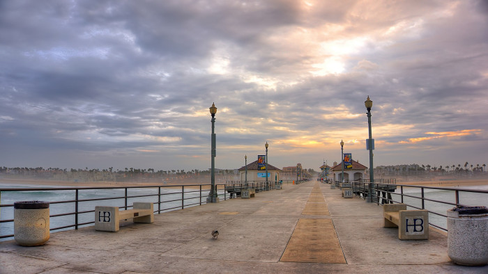 10. Huntington Beach is a relaxing place to listen to waves crash against the pier as the sun rises.